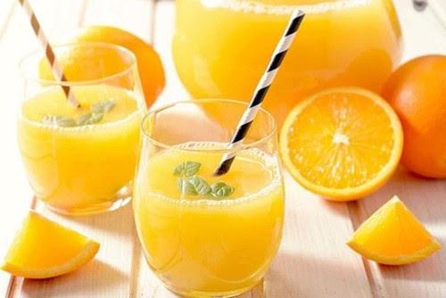 uống nước cam giải rượu